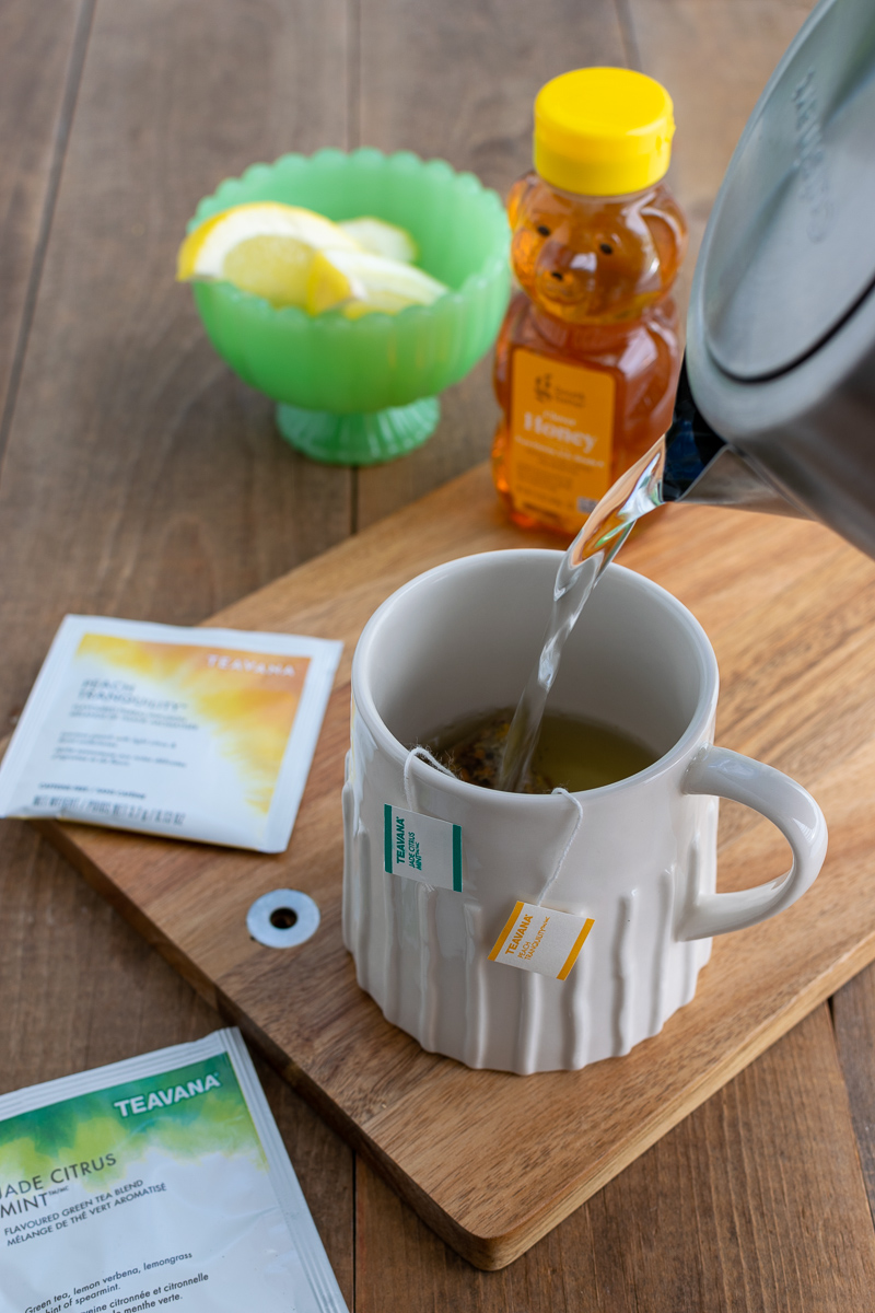 mug of medicine bomb tea made with peach tranquility and jade citrus mint teavana tea bags